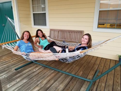 PhD students hanging in the hammocks after a day in the field